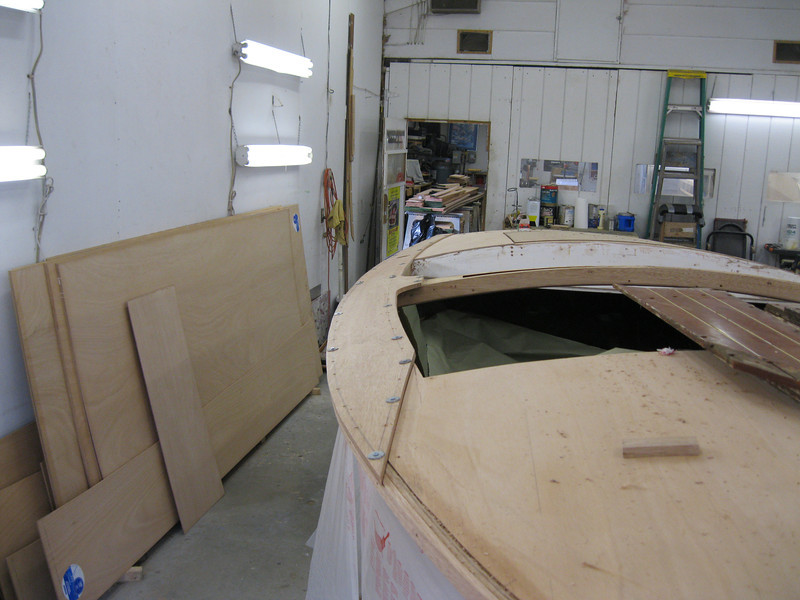 Starboard cover board being fit.