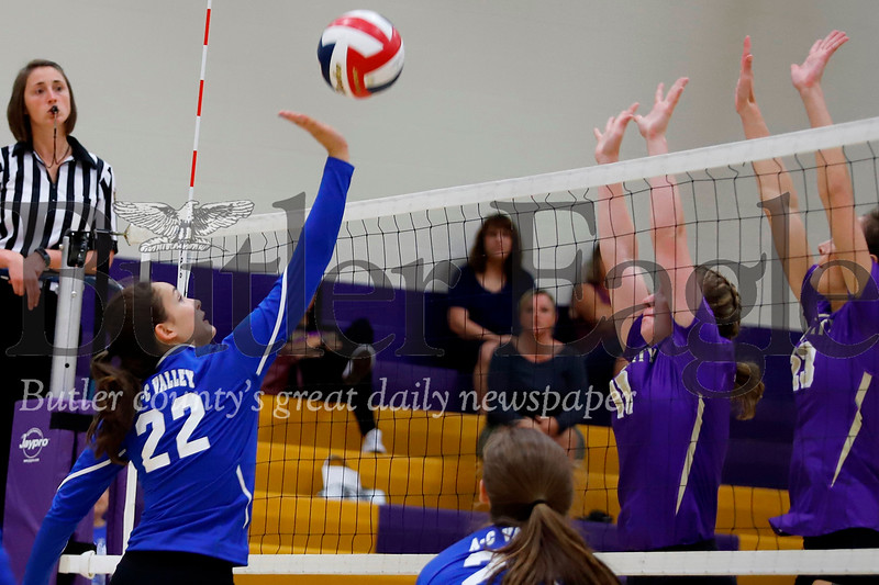 Meah Ielase of AC Valley tries to loft a ball over a Karns City block attempt. AC Valley topped the Gremlins 3-0 Thursday at Karns City. Seb Foltz/Butler Eagle
