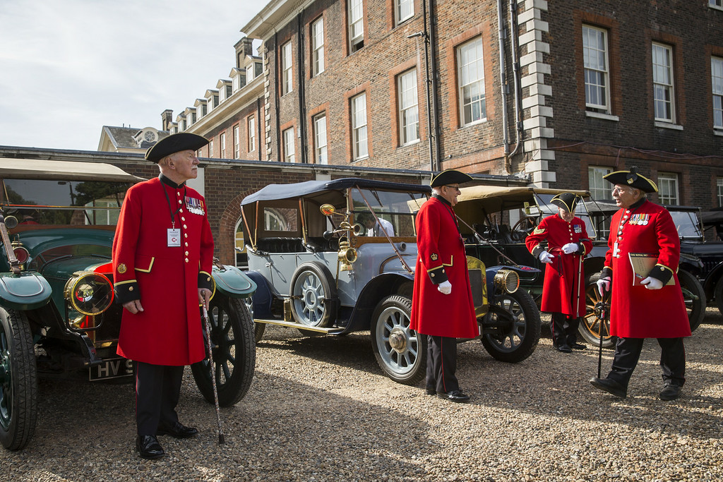 . LONDON, ENGLAND - AUGUST 4:   Chelsea Pensioners prepare to take part in the Great War centenary parade of Edwardian cars through central London at Royal Hospital Chelsea on August 4, 2014 in London, England.  Monday 4th August marks the 100th anniversary of Great Britain declaring war on Germany. In 1914 British Prime Minister Herbert Asquith announced at 11 pm that Britain was to enter the war after Germany had violated Belgium neutrality. The First World War or the Great War lasted until 11 November 1918 and is recognised as one of the deadliest historical conflicts with millions of causalities. A series of events commemorating the 100th anniversary are taking place throughout the day.  (Photo by Rob Stothard/Getty Images)