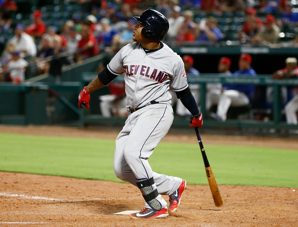 . Cleveland Indians\' Jose Ramirez watches his double against the Texas Rangers during the 11th inning of a baseball game, Friday, July 20, 2018, in Arlington, Texas. The Indians won 9-8. (AP Photo/Jim Cowsert)