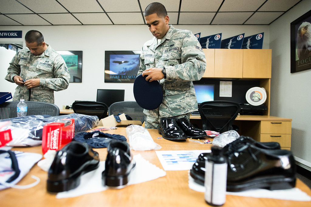. Airman First Class Brenden Sylvester preps his ceremonial uniform hat at March Air Reserve Base in Riverside, Calif. on Monday, May 18, 2015. (Photo by Watchara Phomicinda/ Los Angeles Daily News)