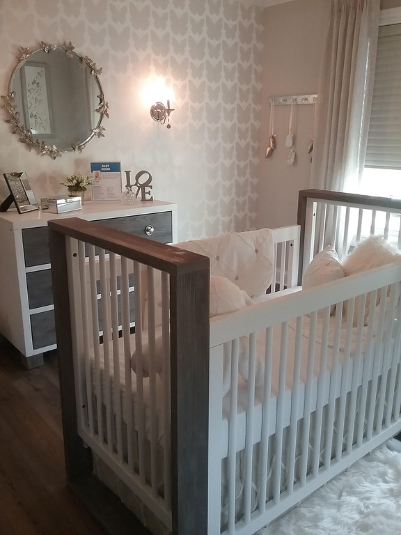 . The Baby Glam nursery designed by Tracy Baker of Design Details in Mentor features wallpaper and a mirror with a butterfly motif. (Jean Bonchak)