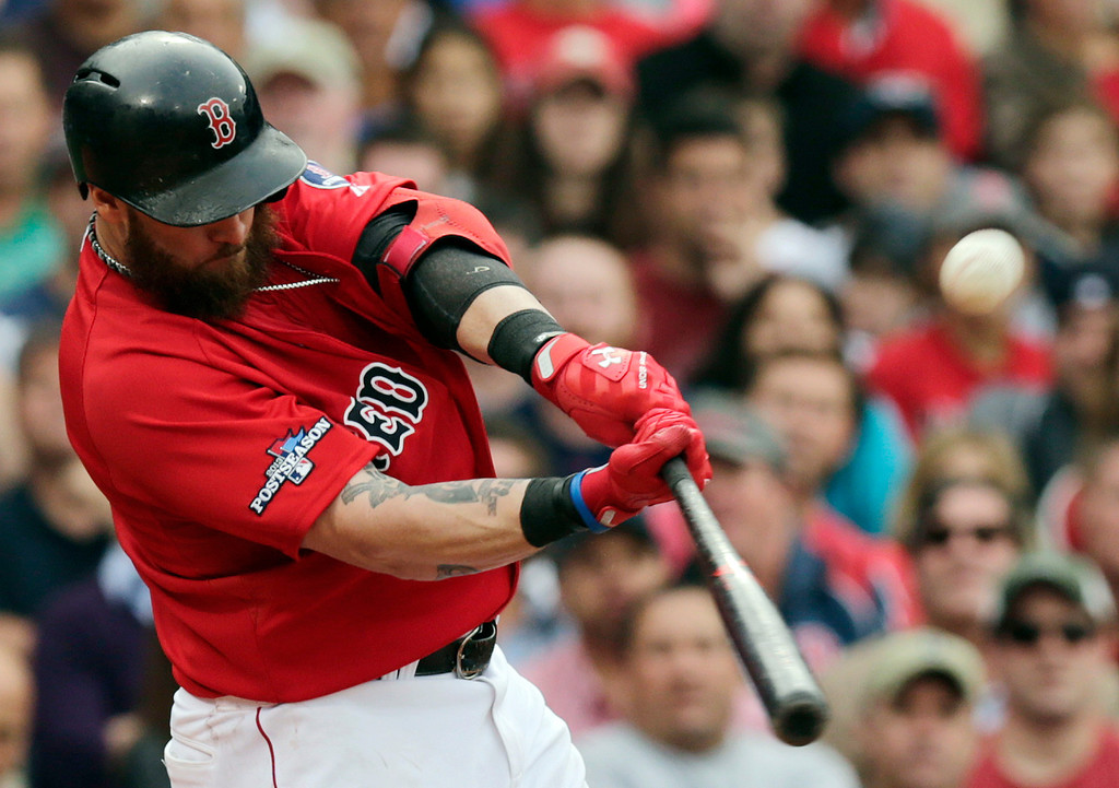 . Boston Red Sox left fielder Jonny Gomes hits a two-run double off Tampa Bay Rays starting pitcher Matt Moore in the fourth inning in Game 1 of baseball\'s American League division series, Friday, Oct. 4, 2013, in Boston. (AP Photo/Charles Krupa)