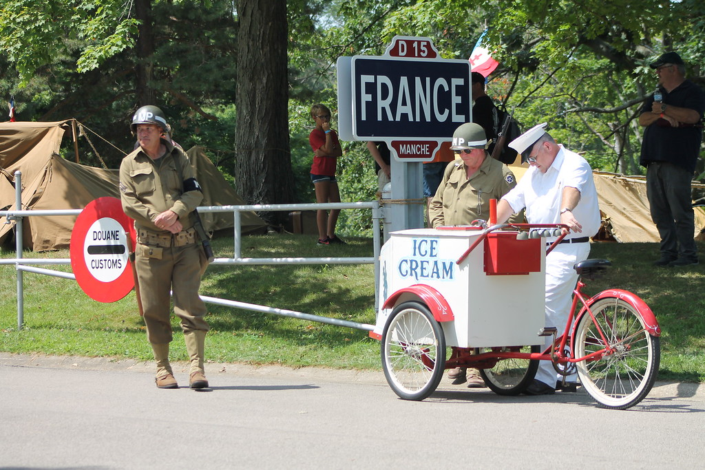 . An Ice vendor sells ice cream from a bike like they did during the 1940s at D-Day Conneaut 2018. Kristi Garabrandt - The News-Herald