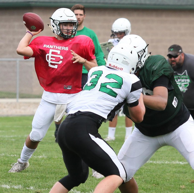 . Randy Meyers - The Morning Journal Elyria Catholic quarterback Cameron Engrish throws to his left with line protection during a scrimmage against Columbia.