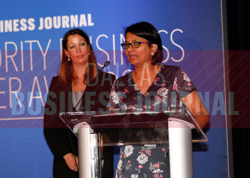 Shanthi Rajaram, President & CEO, Amazech Solutions (right) accepts her Minority Business Leader award.