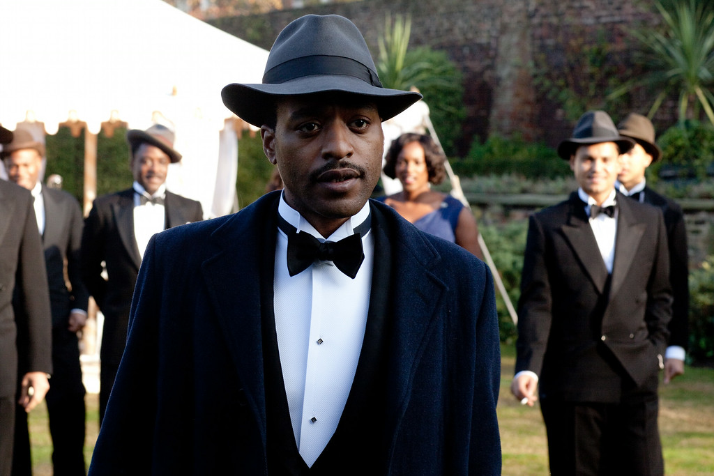 """. This image released by Starz shows Chiwetel Ejiofor in \""""Dancing on the Edge.\"""" Ejiofor was nominated for an Emmy Award for best actor in a miniseries or movie on Thursday, July 10, 2014. The 66th Primetime Emmy Awards will be presented Aug. 25 at the Nokia Theatre in Los Angeles. (AP Photo/Starz)"""