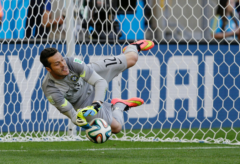 . Brazil\'s goalkeeper Julio Cesar makes a save during a penalty shootout following regulation time during the World Cup round of 16 soccer match between Brazil and Chile at the Mineirao Stadium in Belo Horizonte, Brazil, Saturday, June 28, 2014. Brazil won 3-2 on penalties after a 1-1 tie. (AP Photo/Ricardo Mazalan)