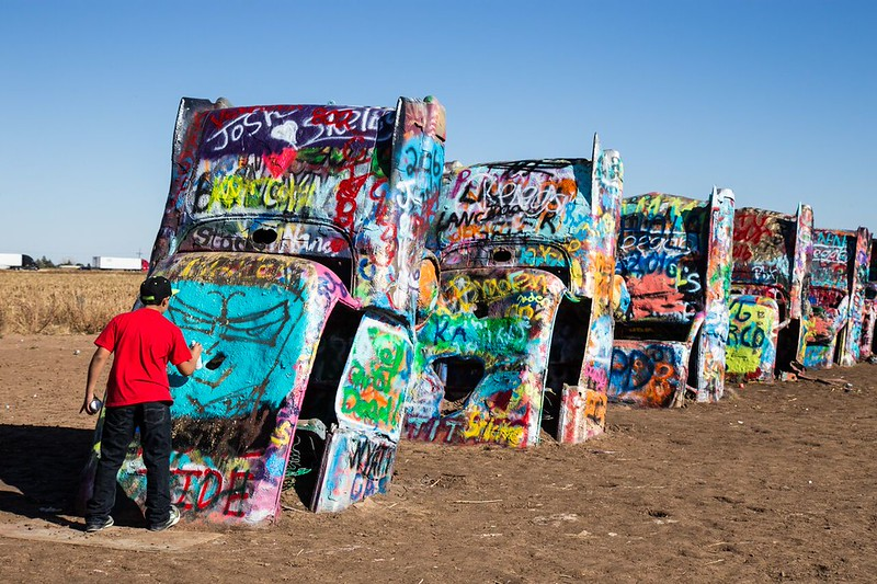 Graffiti covered cars at Cadillac Ranch