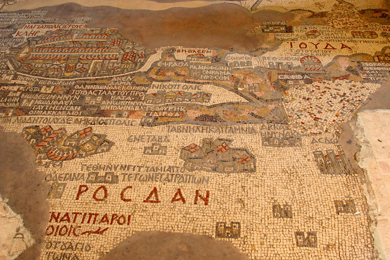 Madaba - St George's Church and mosaic map - section containing a map of Jerusalem (top left) surrounded by the city walls, containing gates, the central road (cardo) and the Church of the Holy Sepulchre (centre bottom of city).