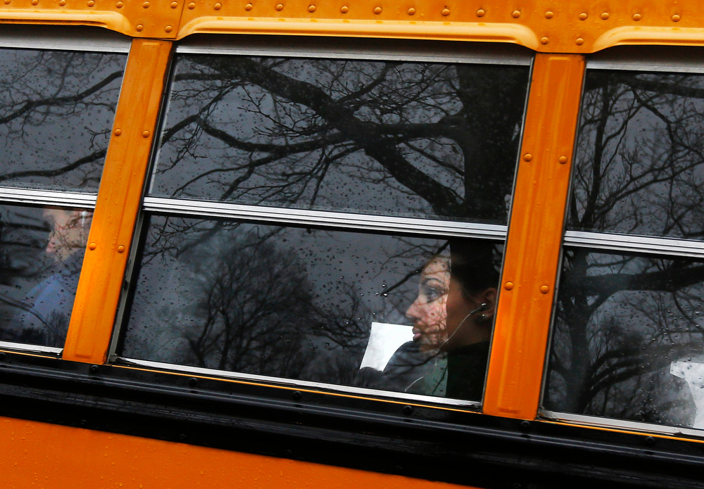. A Newtown school district student is seen on a school bus carrying students in Newtown, Connecticut December 18, 2012. The schools of Newtown, which stood empty in the wake of a shooting rampage that took 26 of their own at Sandy Hook Elementary, will again ring with the sounds of students and teachers on Tuesday as the bucolic Connecticut town struggles to return to normal.  REUTERS/Shannon Stapleton