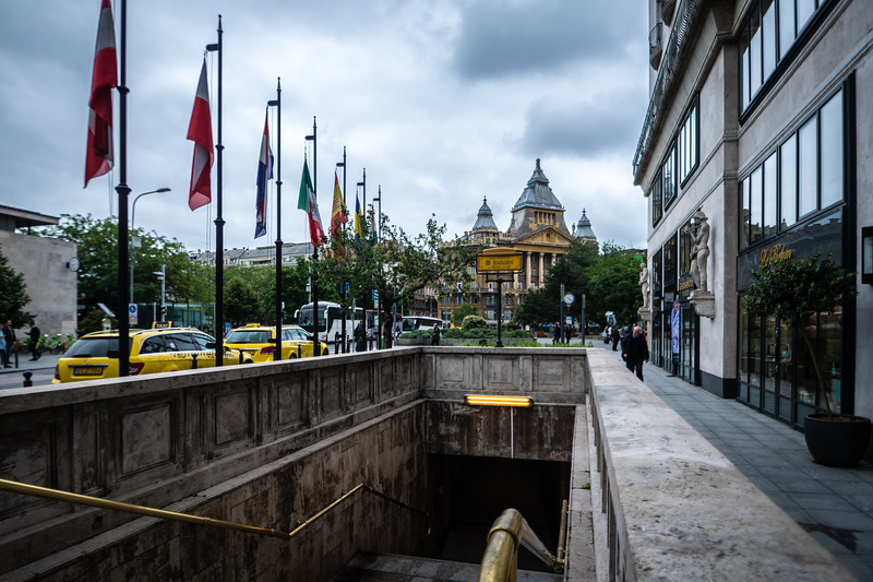 A contrast of centuries-old buildings, modern buildings, and a subway.