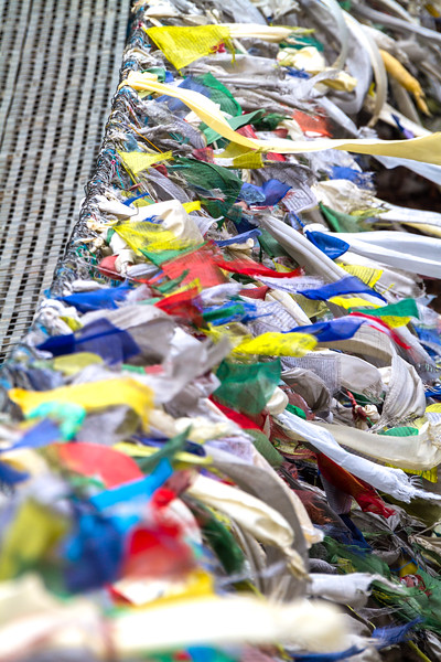 Prayer flags on bridge over Dudh Kosi River