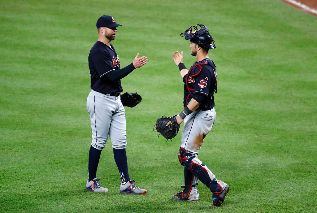 . Cleveland Indians starting pitcher Corey Kluber, left, and catcher Yan Gomes celebrate after closing out a baseball game against the Baltimore Orioles in Baltimore, Monday, June 19, 2017. Cleveland won 12-0. (AP Photo/Patrick Semansky)