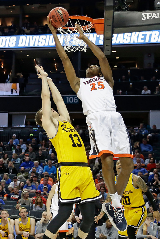 . Virginia\'s Mamadi Diakite (25) shoots over UMBC\'s Joe Sherburne (13) during the first half of a first-round game in the NCAA men\'s college basketball tournament in Charlotte, N.C., Friday, March 16, 2018. (AP Photo/Gerry Broome)