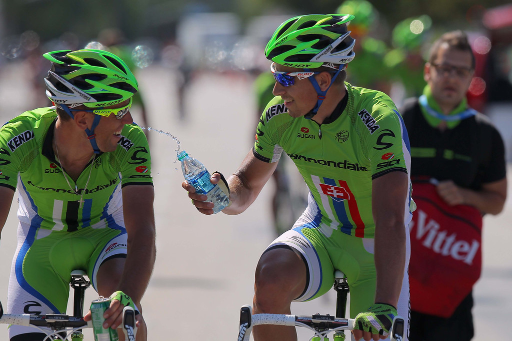 . Peter Sagan of Slovakia riding for Cannondale Pro Cycling celebrates his win as he douses his teammate Guillaume Boivin of Canada riding for Cannondale Pro Cycling in Stage Three of the 2013 Amgen Tour of California from Palmdale to Santa Clarita on May 14, 2013 in Santa Clarita, California.  (Photo by Doug Pensinger/Getty Images)