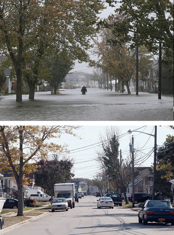 . LINDENHURST, NY - OCTOBER 29: (top) A lone figure makes his way down South 9th Street as high tide, rain and winds flood local streets on October 29, 2012 in Lindenhurst, New York. The storm, which threatens 50 million people in the eastern third of the U.S., is expected to bring days of rain, high winds and possibly heavy snow. LINDENHURST, NY - OCTOBER 22: (bottom) A scenic view of South 9th Street as photographed almost one year following Superstorm Sandy on October 22, 2013 in Lindenhurst, New York. Hurricane Sandy made landfall on October 29, 2012 near Brigantine, New Jersey and affected 24 states from Florida to Maine and cost the country an estimated $65 billion. (Photos by Bruce Bennett/Getty Images)