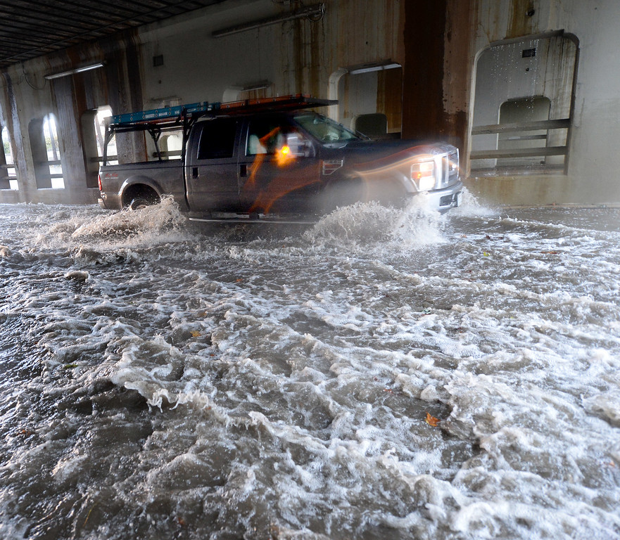 . A car drives through standing water along Santa Clara Street at the Caltrain underpass in San Jose, Calif., on Thursday, Dec. 11, 2014. The big storm made its way south, after pounding the North Bay in the early morning hours. Flooding caused the eventual closing of the street. (Dan Honda/Bay Area News Group)