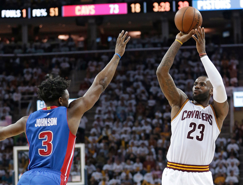 . Cleveland Cavaliers\' LeBron James (23) shoots over Detroit Pistons\' Stanley Johnson (3) during the second half in Game 2 of a first-round NBA basketball playoff series, Wednesday, April 20, 2016, in Cleveland. The Cavaliers won 107-90. (AP Photo/Tony Dejak)