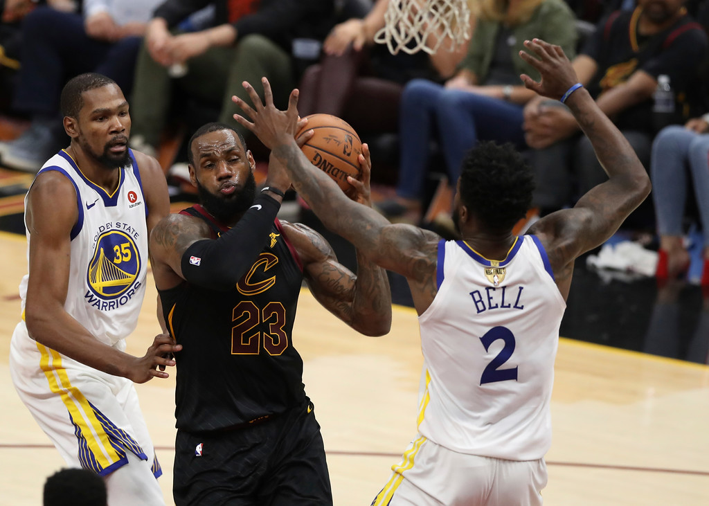 . Cleveland Cavaliers\' LeBron James goes to the basket against Golden State Warriors\' Jordan Bell in the first half of Game 3 of basketball\'s NBA Finals, Wednesday, June 6, 2018, in Cleveland. (AP Photo/Carlos Osorio)