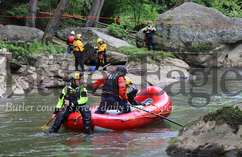 Butler County Water Rescue Team 300 members search for the body of a hiker Saturday at McConnells Mill. Wittnesses saw Jeffrey Hamby II of Meadville fall into Slippery Rock creek back on May 2; state park rangers and volunteer groups have been searching since his disapearance. Seb Foltz/Butler Eagle