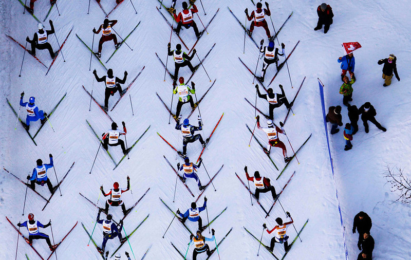. Cross-country skiers climbing a hill during the Engadin Ski Marathon near the village of Maloja March 10, 2013. More than 12,000 skiers participated in the 26.2 miles race between Maloja and S-chanf near the Swiss mountain resort of St. Moritz. REUTERS/Michael Buholzer