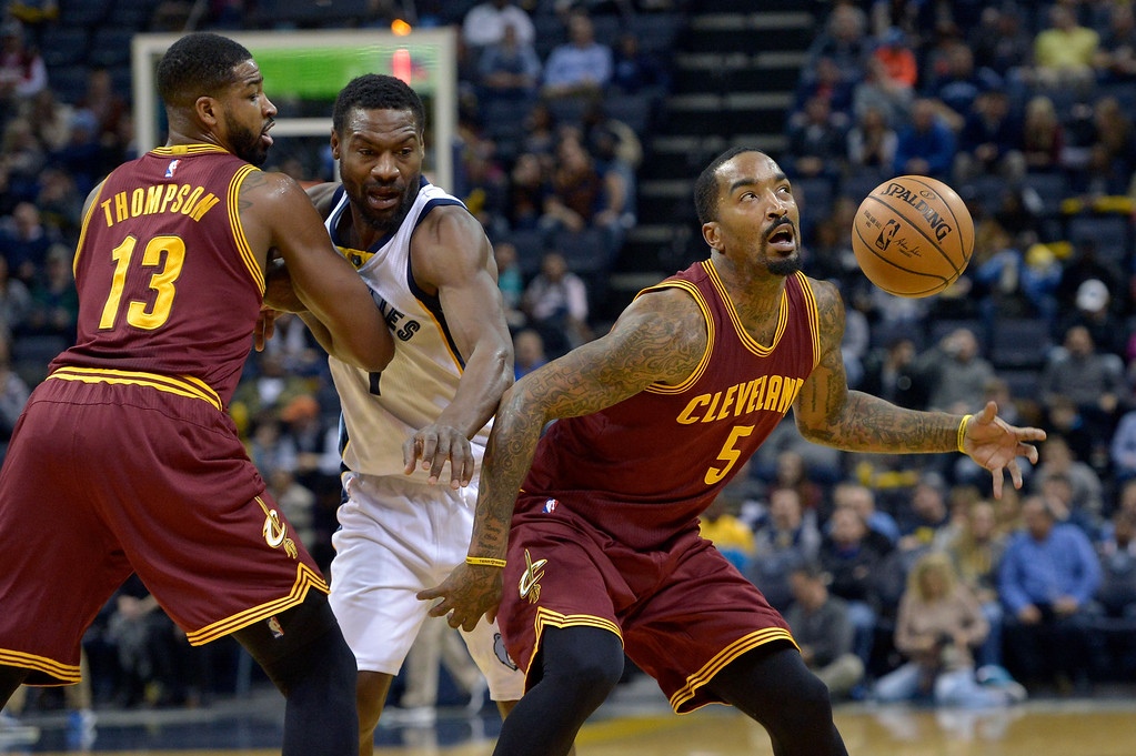 . Cleveland Cavaliers guard J.R. Smith (5) looks toward the ball after Memphis Grizzlies guard Tony Allen, center, reached past Cavaliers center Tristan Thompson (13) to knock it loose in the first half of an NBA basketball game, Wednesday, Dec. 14, 2016, in Memphis, Tenn. (AP Photo/Brandon Dill)