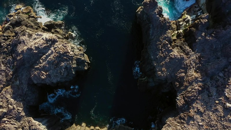 Available in 4K - Aerial video clip of waves hitting the black lava coast of Ponta do Mistério at Terceira Island