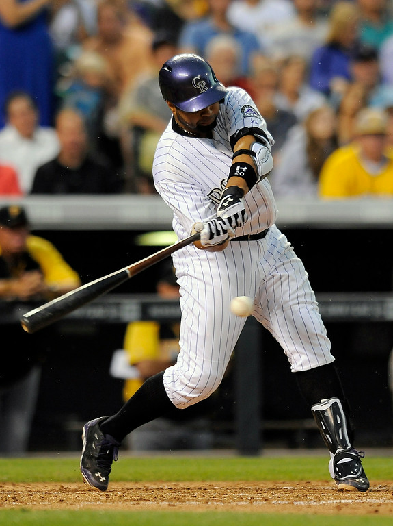 . Colorado Rockies Wilin Rosario hits a single in the fourth inning of a baseball game against the Pittsburgh Pirates on Friday, July 25, 2014, in Denver. (AP Photo/Chris Schneider)