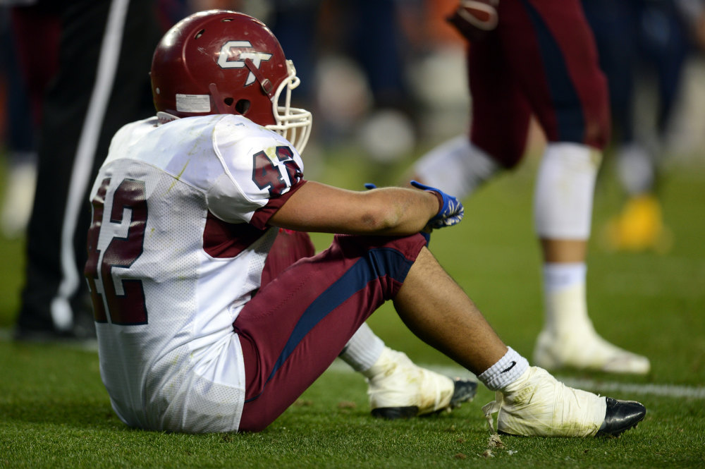 . Cherokee Trail LB D\'Andre Thortvedt sat on the field after a touchdown by Valor Christian RB Christian McCaffrey during the 5A State Championship game at Sports Authority Field at Mile High on Saturday in Denver, CO on December 1, 2012. Hyoung Chang, The Denver Post