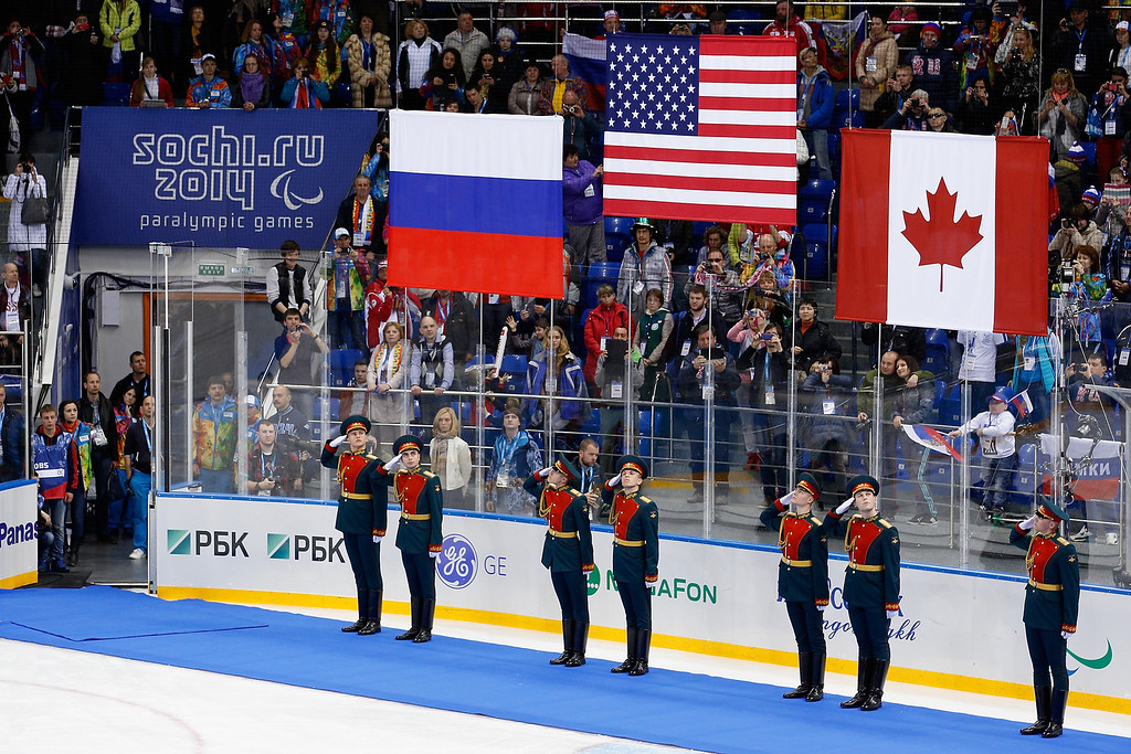 . The flags of Russia, USA and Canada are raised during the medal ceremony following the Ice Sledge Hockey Gold Medal match between Russia and USA at the Shayba Arena during day eight of the 2014 Paralympic Winter Games on March 15, 2014 in Sochi, Russia.  (Photo by Harry Engels/Getty Images)