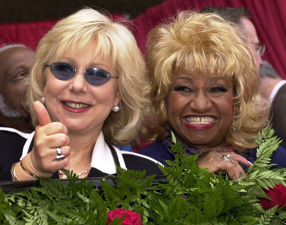 ". LOS ANGELES, UNITED STATES:  Cuban singer Celia Cruz (R) and talk show host Cristina Saralegui (L) watch as a star is unveiled on the Hollywood Walk of Fame for Chilean television host Don Francisco (Mario Kreutzberger) in Los Angeles 08 June 2001.  Don Francisco hosts Spanish television\'s longest running programme ""Sabado Gigante\"".    (LUCY NICHOLSON/AFP/Getty Images)"