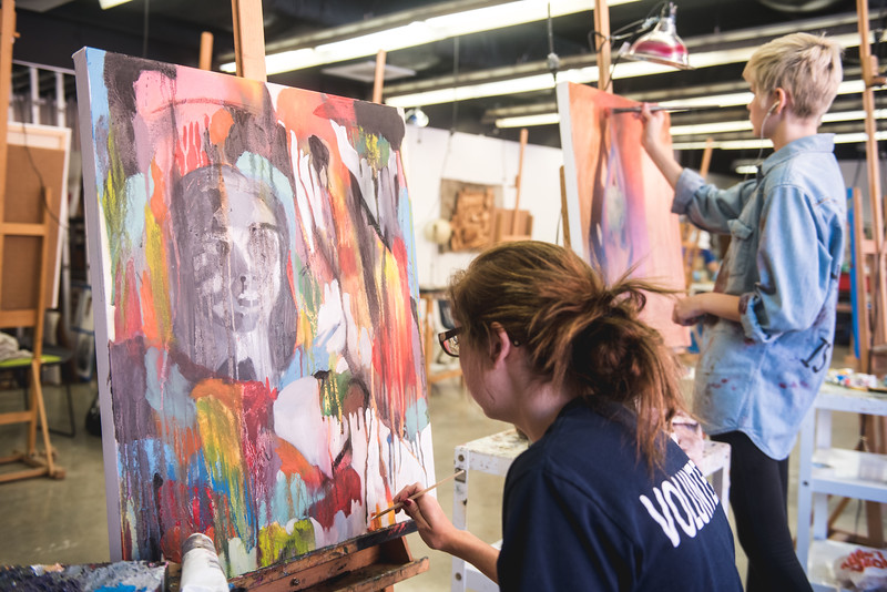 Student Payton Torres adds to her art piece in her Painting 2 class.