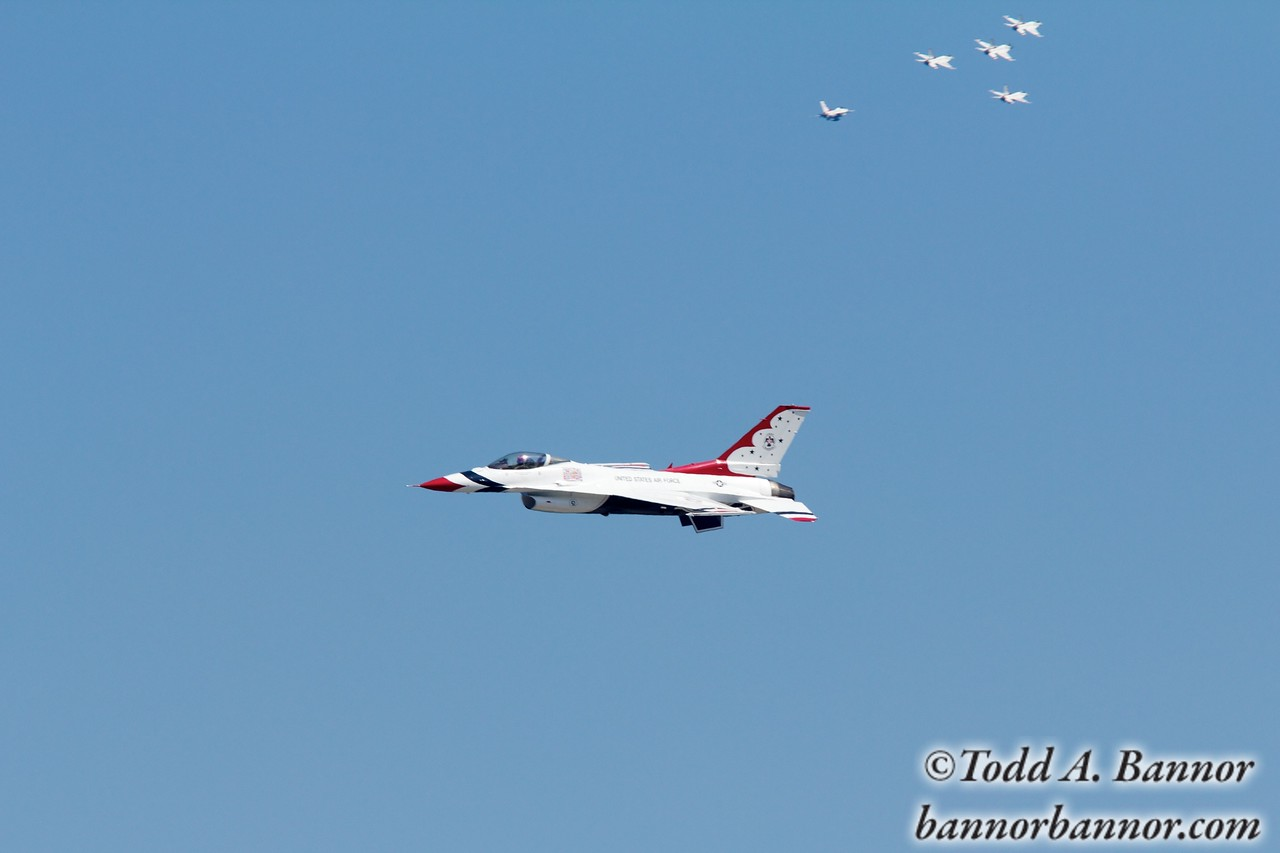U.S. Air Force Thunderbirds F16 Fighting Falcon. Thunderbird 5 with numbers 1, 2, 3 and 4 in background tailed by #8, a two seater.