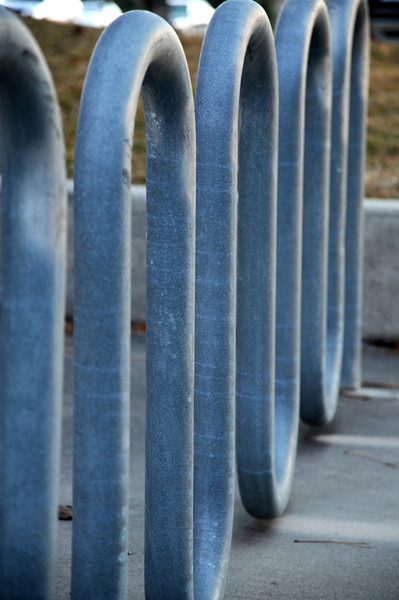 2011/3/14 – Today was a busy day at work so I tried a different perspective of something I already shot. This is the bike rack at our office I shot back on 2/28. Sometimes it is fun to explore the same subject more than once. Check out both images and see which one you like best.