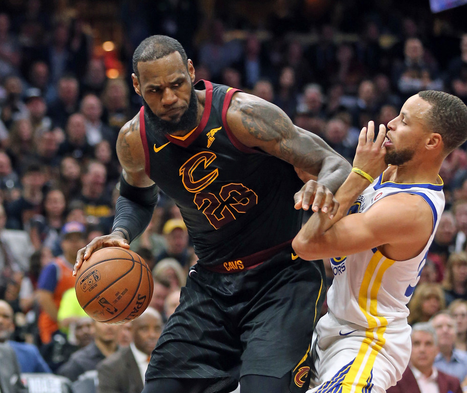 . Cleveland Cavaliers forward LeBron James looks to move past Golden State Warriors guard Stephen Curry during the first half of Game 3 of basketball\'s NBA Finals on Wednesday, June 6, 2018, in Cleveland. (Joshua Gunter/The Plain Dealer via AP)
