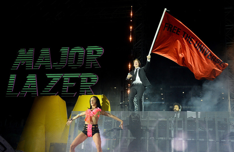 . A dancer performs in front of DJ/producers Diplo and Jillionaire of Major Lazer at the 17th annual Electric Daisy Carnival at Las Vegas Motor Speedway on June 23, 2013 in Las Vegas, Nevada.  (Photo by Ethan Miller/Getty Images)