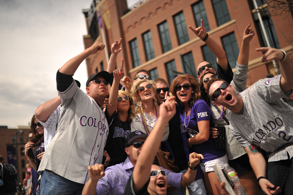 . Fans take a group photo outside the ballpark before the start of the game. The Colorado Rockies took on the San Diego Padres on Opening Day at Coors Field in Denver, Colorado. (Photo by Hyoung Chang/The Denver Post)