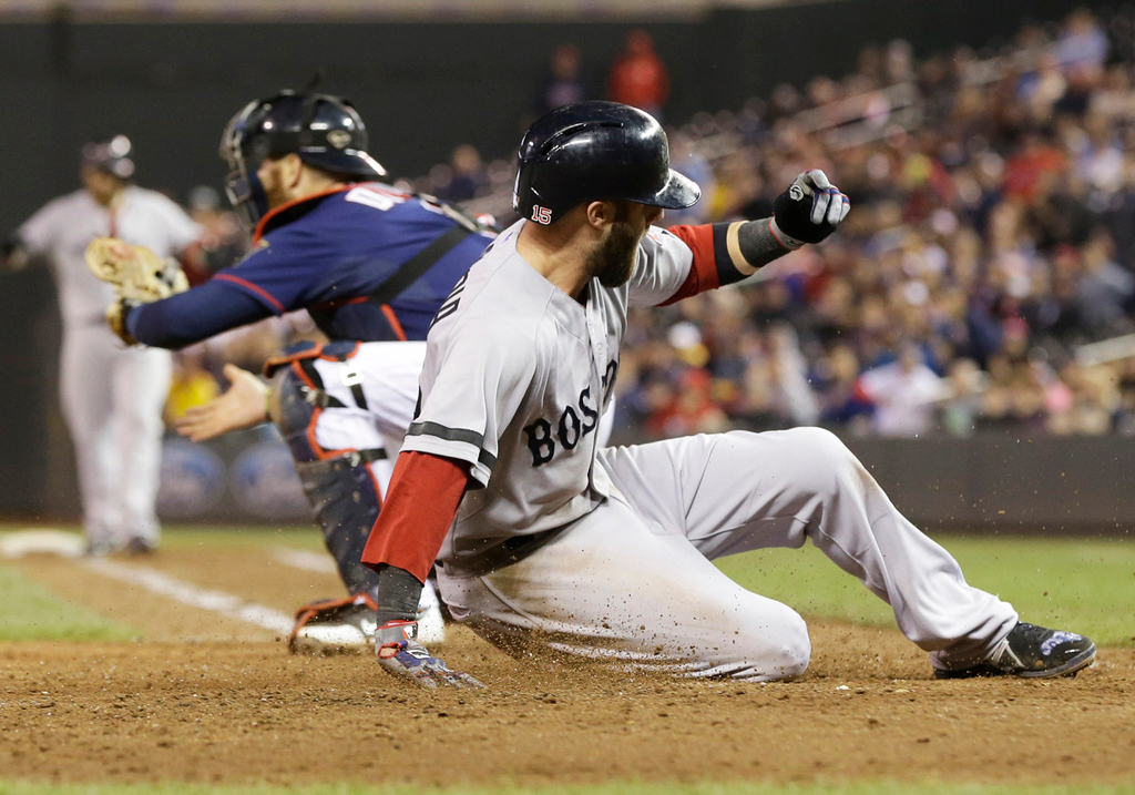 . Boston\'s Dustin Pedroia beats the throw to Minnesota Twins catcher Ryan Doumit to score on a sacrifice fly by Jonny Gomes off Twins pitcher Josh Roenicke in the 10th inning to give the Red Sox a 3-2 win over Minnesota on Friday, May 17, 2013, at Target Field. (AP Photo/Jim Mone)