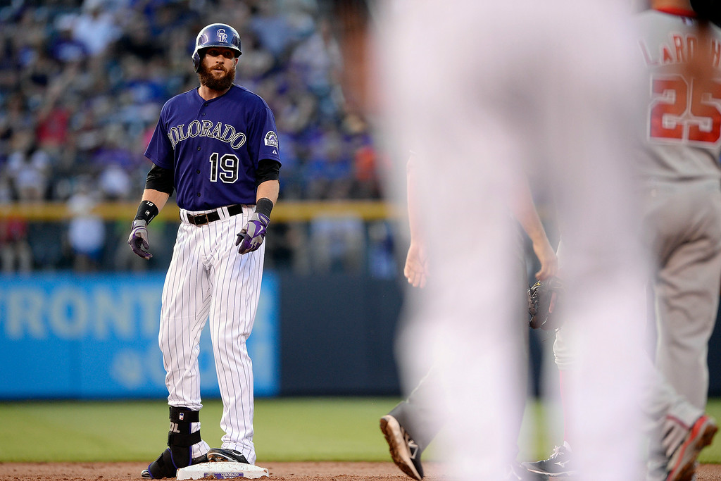 . Charlie Blackmon (19) of the Colorado Rockies stands on second base after hitting a double off of Doug Fister (58) of the Washington Nationals at Coors Field. Major League Baseball action between the Colorado Rockies and the Washington Nationals on Monday, July 21, 2014. (Photo by AAron Ontiveroz/The Denver Post)