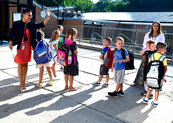 8/29/2018 Mike Orazzi | Staff Principal Kimberly Loveland (left) welcomes students on the first day of school at the Fisher Middle School in Plymouth Wednesday morning.