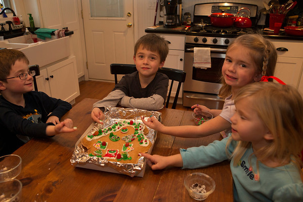 May ,Sam ,and Liam take a turn on Decorating a Big Sugar Cookie.