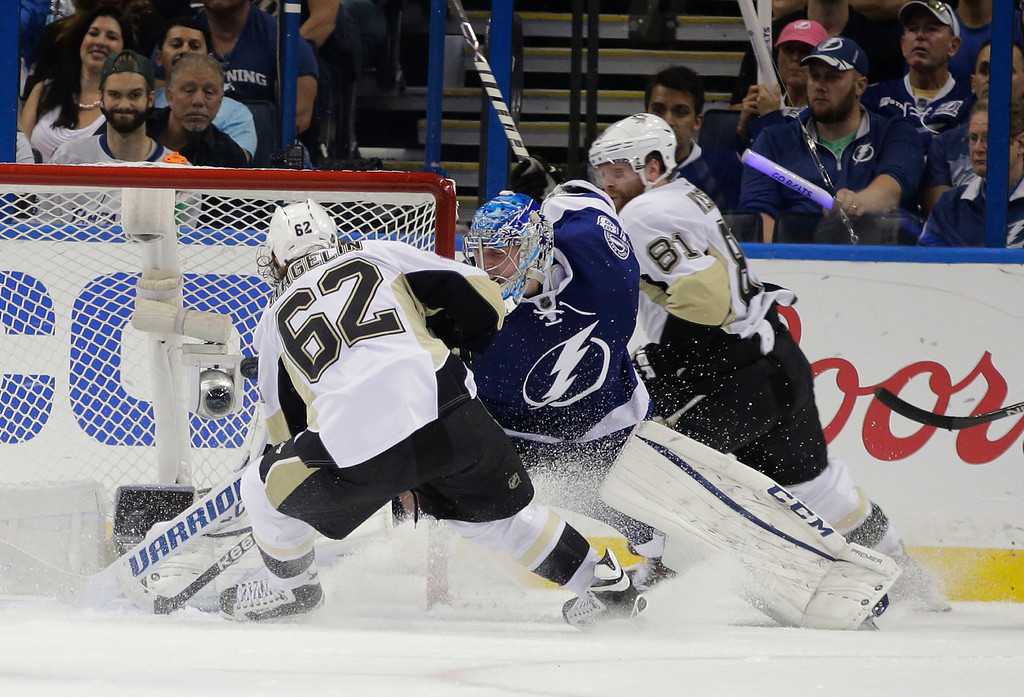 . Pittsburgh Penguins left wing Carl Hagelin (62), of Sweden, scores a goal against Tampa Bay Lightning goalie Andrei Vasilevskiy, of Russia, during the second period of Game 3 of the NHL hockey Stanley Cup Eastern Conference finals Wednesday, May 18, 2016, in Tampa, Fla. Penguins right wing Phil Kessel (81) got an assist on the goal. (AP Photo/Chris O\'Meara)