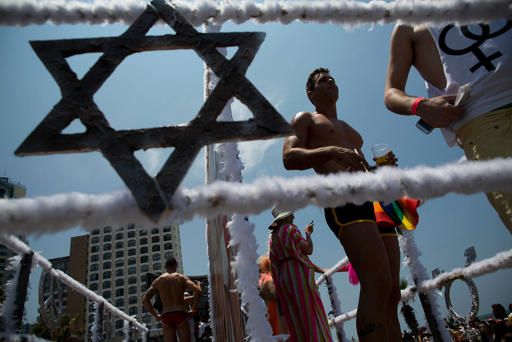 . Israeli dancers perform during the annual Gay Pride Parade on a street of Tel Aviv, Israel, Friday, June 13, 2014. (AP Photo/Oded Balilty)