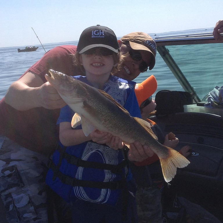 . Eli Boone, 7, of Inver Grove Heights hooked this 23-inch walleye May 24 of Leech Lake while fishing with his uncle Tim Wallace. (Photo courtesy Marc Boone)
