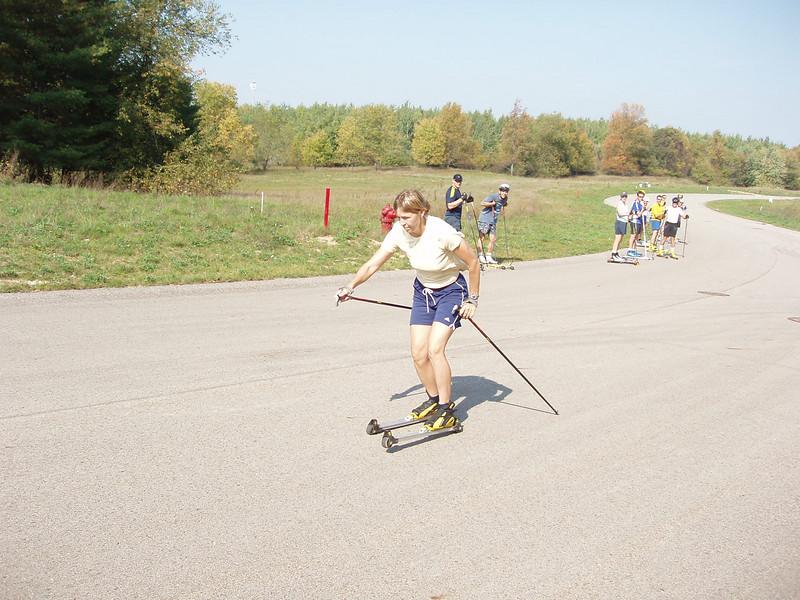 Coach Jenny Ryan striding on rollerskis