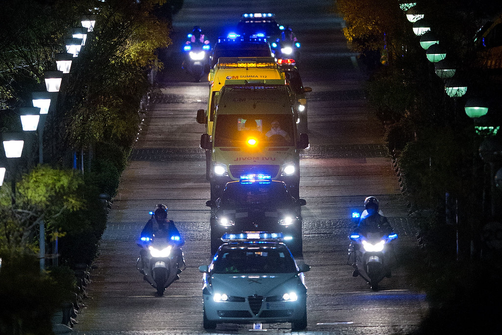 . Police escort an ambulance that carries the Spanish nurse infected by Ebola to Carlos III Hospital from Alcorcon Hospital on October 7, 2014 in Alcorcon, Spain.  (Photo by Gonzalo Arroyo Moreno/Getty Images)