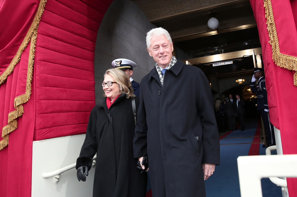 Description of . Former U.S. President Bill Clinton and Secretary of State Hillary Clinton arrive for the presidential inauguration on the West Front of the U.S. Capitol in Washington January 21, 2013.   REUTERS/Win McNamee/Pool