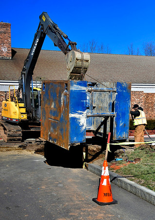 1/29/2020 Mike Orazzi | StaffrCrews work to repair a water main break on Wednesday at Plymouth Town Hall.