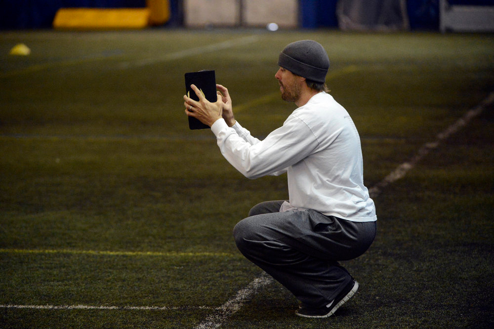 . Former Denver Broncos quarterback, Jake Plummer, uses a computer tablet to video former Kansas State star quarterback, Collin Klein, (not pictured) during footwork drills inside the South Suburban Parks and Recreation\'s Sport Dome in Centennial, Colorado, Thursday morning, February 14th, 2013.  Plummer has spent weeks with Klein preparing him for the upcoming NFL Scouting Combine in Indianapolis, Indiana February 20th thru February 26th 2013. (Photo By Andy Cross / The Denver Post)